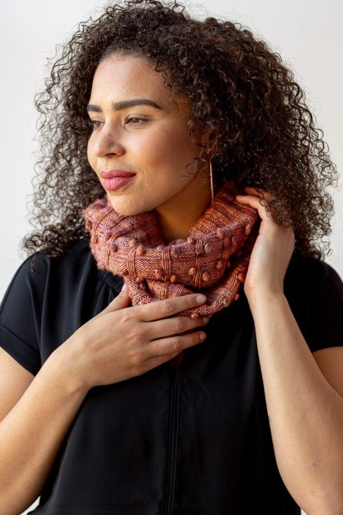 Beautiful model wearing pink handknit cowl