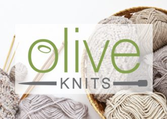 collection of neutral color yarn and knitting needles with name Olive Knits overlayed