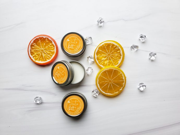 round metal tins with cuticle cream - yellow labels and fruit slice decorations